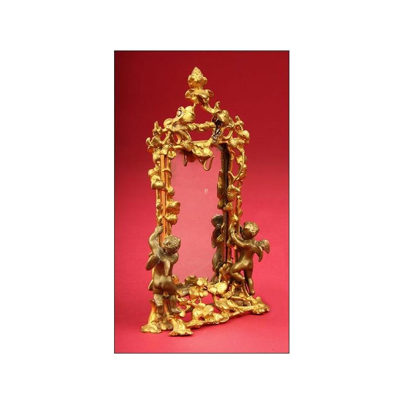 Precioso Porta-relojes en Bronce dorado fabricado en 1900.