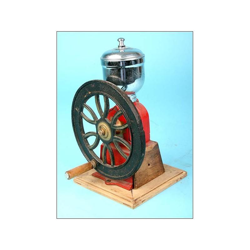 Molinillo de café de rueda. Antiguo