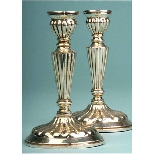 Conjunto de candeleros españoles en plata de ley