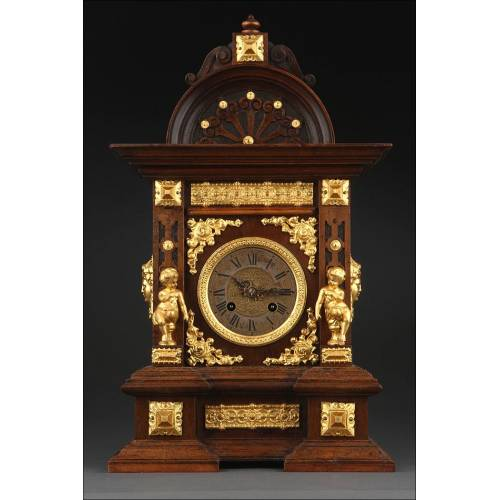 Impresionante Reloj de Sobremesa de Madera y Bronce Dorado. Alemania, Siglo XIX. Funcionando