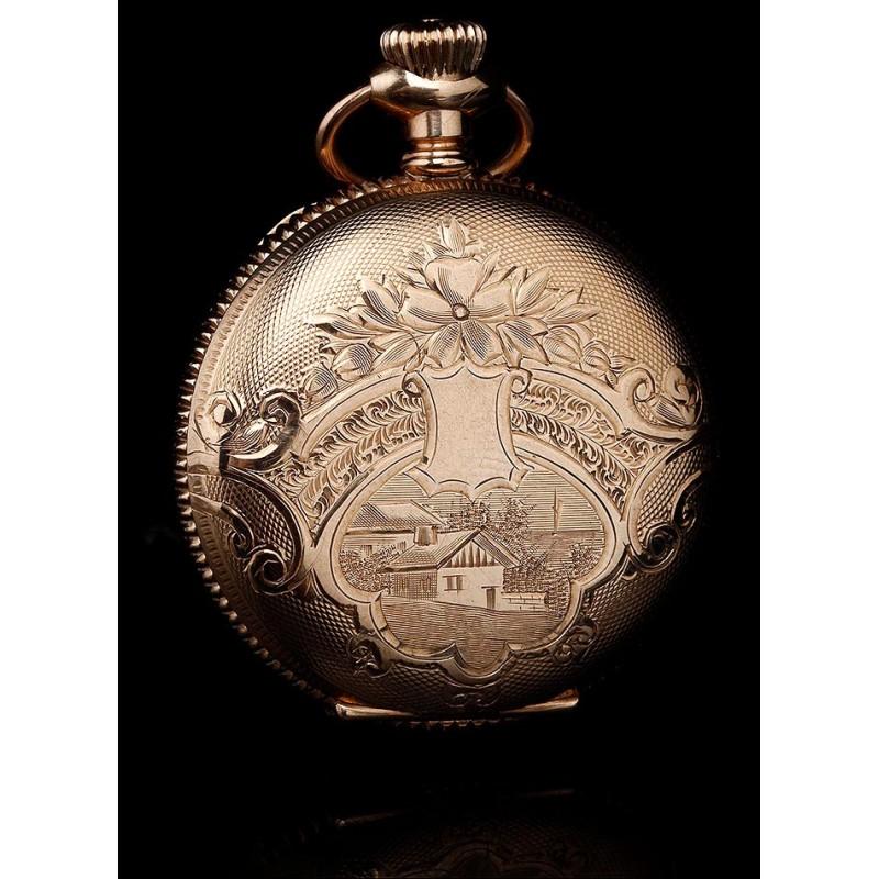 Bello reloj de bolsillo chapado en oro marca Elgin. Fabricado en EEUU circa 1900. Grabado a mano.