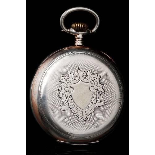 Elegante Reloj de Bolsillo Omega de Plata Maciza y con Contrastes. Suiza, Circa 1920