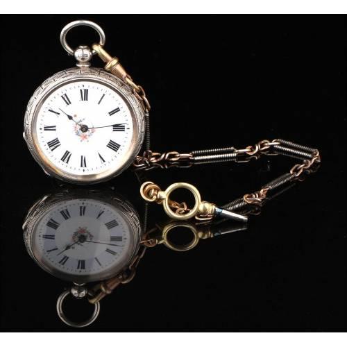 Precioso Reloj de Bolsillo Inglés en Plata Maciza. Con Llave y Cadena. Año 1885