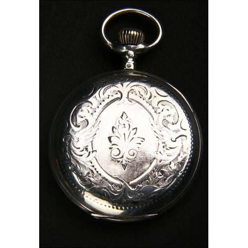 Reloj de bolsillo en plata maciza de alrededor de 1900.