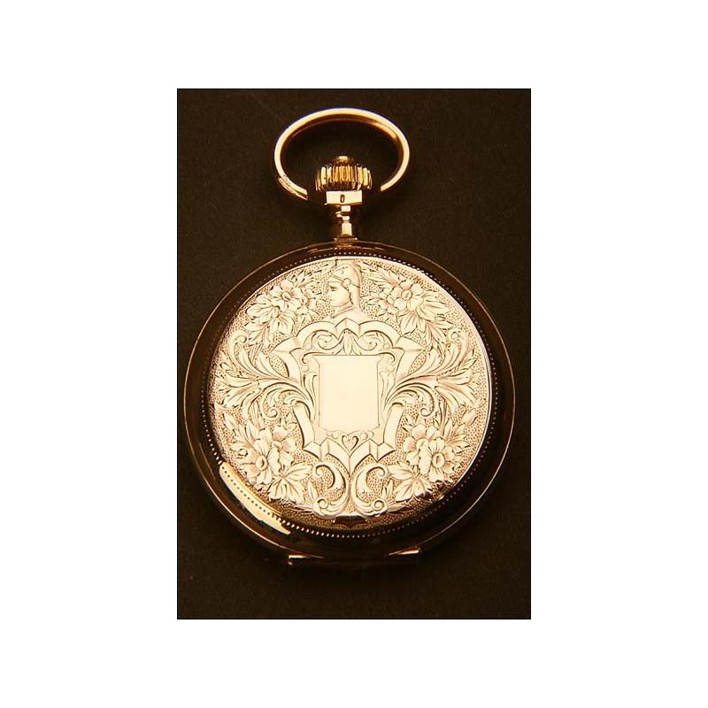 Reloj de bolsillo en oro macizo. Tres tapas. 15 rubíes. 1900