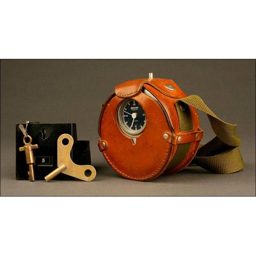 Auténtico Reloj de Sereno Schlumberger Flonic en Metal con Estuche de Cuero. Francia, años 60.